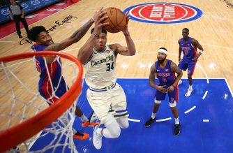 DETROIT, MICHIGAN - DECEMBER 04: Giannis Antetokounmpo #34 of the Milwaukee Bucks drives to the basket past Langston Galloway #9 of the Detroit Pistons during the second half at Little Caesars Arena on December 04, 2019 in Detroit, Michigan. Milwaukee won the game 127-103. NOTE TO USER: User expressly acknowledges and agrees that, by downloading and or using this photograph, User is consenting to the terms and conditions of the Getty Images License Agreement.   Gregory Shamus/Getty Images/AFP