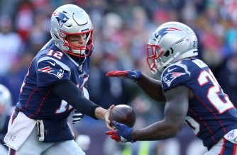 FOXBOROUGH, MASSACHUSETTS - DECEMBER 29: Tom Brady #12 of the New England Patriots hands the ball off to Sony Michel #26 during the game against the Miami Dolphins at Gillette Stadium on December 29, 2019 in Foxborough, Massachusetts.   Maddie Meyer/Getty Images/AFP