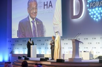 "Mahathir Mohamad, Prime Minister of Malaysia (C), and Tamim ben Hamad Al Thani, Emir of Qatar (R) attend the Doha Forum 2019 at the Sheraton Grand Doha Resort & Convention Hotel in Doha, Qatar, December 14th of 2019. (Photo credit should read ""AMMAR ABD RABBO/DOHA FORUM 2019/AFP-Services"")"