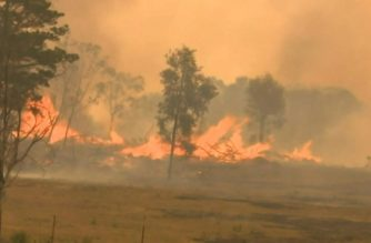 Out of control bushfires forced residents in eastern Australia to flee their homes, as other parts of the country braced for a heatwave due next week.  (Photo grabbed from AFPTV video/Courtesy AFPTV)