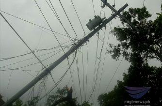 Typhoon Kammuri (TisoyPH) topples big electric posts in Camalig, Albay.  Photo courtesy Rebert Soriao, Eagle News Service)