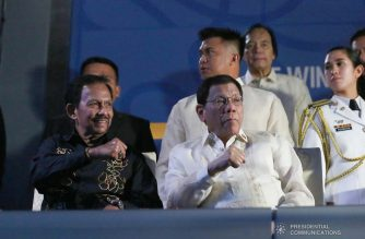 President Rodrigo Duterte strikes his signature pose with His Majesty Sultan Haji Hassanal Bolkiah, Sultan and Yang Di-Pertuan of Negara Brunei Darussalam during the opening ceremony of the 30th Southeast Asian (SEA) Games at the Philippine Arena in Bocaue, Bulacan on November 30, 2019. REY BANIQUET/PRESIDENTIAL PHOTO