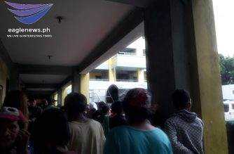 "Residents from Isla Puting Bato were forcibly evacuated by the Manila government due to ""Tisoy.""/Moira Encina/Eagle News/"
