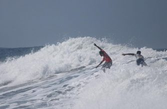 Filipino surfer Roger Casugay opted to rescue his Indonesian opponent, Arip Nurhidayat, than get the gold in the SEA Games surfing competition in La Union. The Indonesian's leash had been detached from his surfboard. He was being hit by strong waves at that time./Jefferson Ganuelas/SEA Games FB/
