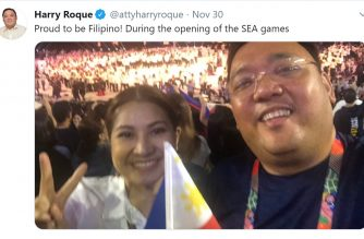 "Former Presidential Spokesperson Harry Roque tweets a photo of him and his wife during the 30th SEA Games opening ceremonies inside the Philippine Arena.  ""Proud to be Filipino,"" he says.  (Photo grabbed from twitter page of former presidential spokerson Harry Roque/Courtesy https://twitter.com/attyharryroque)"