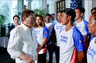 President Duterte meets Filipino hero surfer Roger Casugay