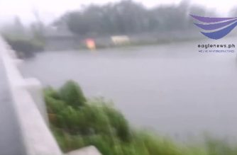 Watch:  Typhoon Tisoy's strongs winds and rains as seen at Bucayao river bridge in Calapan, Mindoro Oriental