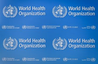 Signs of the World Health Organization (WHO) are seen on May 18, 2018 at the United Nations Office in Geneva. - An Ebola outbreak in Democratic Republic of the Congo has a high risk of spreading internally, the World Health Organization warned ahead of a meeting on whether to declare it an event of international concern. (Photo by Fabrice COFFRINI / AFP)