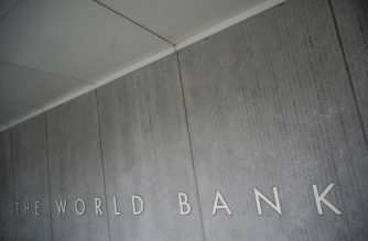 The World Bank Group logo is seen on the building of the Washington-based global development lender in Washington on January 17, 2019. - World Bank current President Jim Yong Kim announced on January 7, 2019, that he would cut short his tenure as president more than three years before his second term was to end. The World Bank Board said it would start accepting nominations for a new leader early next month and name a replacement for Kim by mid-April 2019. (Photo by Eric BARADAT / AFP)
