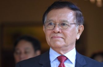 Former opposition leader Kem Sokha looks on after a meeting with US Ambassador to Cambodia Patrick Murphy (not pictured) at his home in Phnom Penh on November 11, 2019. - Cambodia has freed a prominent opposition figure from house arrest more than two years after he was charged with treason, a court spokesperson told AFP on November 10, 2019, after attempts by his colleagues to return to the country were thwarted. (Photo by TANG CHHIN Sothy / AFP)