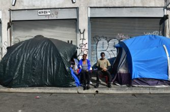 "Tents for the homeless line a sidewalk in Los Angeles, California on December 17, 2019 - The US Supreme Court let a ruling from the 9th Circuit Court of Appeals stand, declining to hear an appeal that would have made it a crime to camp and sleep on public spaces, adding that it was ""cruel and unusual punishment"" to enforce rules against homeless people camping in public places when they have no where else to go. (Photo by Frederic J. BROWN / AFP)"