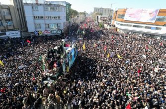 "Iranian mourners gather around a vehicle carrying the coffin of slain top general Qasem Soleimani during the final stage of funeral processions, in his hometown Kerman on January 7, 2020. - Soleimani was killed outside Baghdad airport Friday in a drone strike ordered by US President Donald Trump, ratcheting up tensions with arch-enemy Iran which has vowed ""severe revenge"". The assassination of the 62-year-old heightened international concern about a new war in the volatile, oil-rich Middle East and rattled financial markets. (Photo by ATTA KENARE / AFP)"