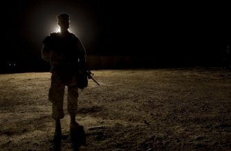 "(FILES) In this file photo taken on September 3, 2007 a US Marine stands guard as the US president visits Al-Asad Air Base in Anbar Province, Iraq. - Iran fired ""more than a dozen"" ballistic missiles on January 7, 2020 against two airbases in Iraq where US and coalition forces are based, the Pentagon said. ""At approximately 5.30 pm (2230 GMT) on January 7, Iran launched more than a dozen ballistic missiles against US military and coalition forces in Iraq,"" Assistant to the Secretary of Defense for Public Affairs Jonathan Hoffman said in a statement. ""It is clear that these missiles were launched from Iran and targeted at least two Iraqi military bases hosting US military and coalition personnel at Al-Assad and Irbil."" (Photo by Jim WATSON / AFP)"