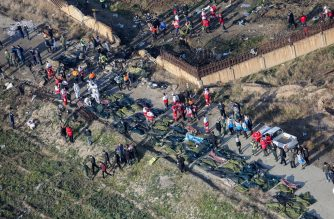 People and rescue teams are pictured amid bodies and debris after a Ukrainian plane carrying 176 passengers crashed near Imam Khomeini airport in the Iranian capital Tehran early in the morning on January 8, 2020, killing everyone on board. - The Boeing 737 had left Tehran's international airport bound for Kiev, semi-official news agency ISNA said, adding that 10 ambulances were sent to the crash site. (Photo by Rouhollah VAHDATI / ISNA / AFP)