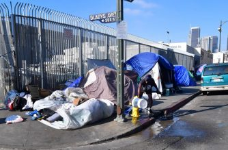 Tents of the homeless line a streetcorner in Los Angeles, California on January 8, 2020. - California Governor Gavin Newsom said his state budget will include more than $1 billion directed towards homelessness, in response to a growing crisis on the streets on California's major cities. (Photo by Frederic J. BROWN / AFP)