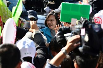 Taiwan's President Tsai Ing-Wen (C) from the ruling Democratic Progressive Party (DPP) is greeted by supporters as she campaigns in Taoyuan on January 9, 2020, ahead of the January 11 presidential and parliamentary elections. (Photo by Sam Yeh / AFP)