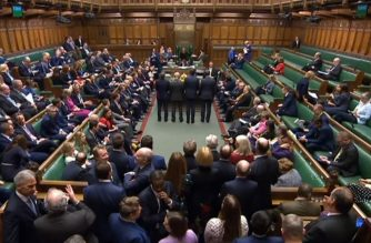 "A video grab from footage broadcast by the UK Parliament's Parliamentary Recording Unit (PRU) shows tellers announcing the result of a vote on the third reading of the European Union (Withdrawal Agreement) Bill, in the House of Commons in London on January 9, 2020. - The European Union (Withdrawal Agreement) Bill has cleared the House of Commons after getting its third reading by 330 votes to 231. (Photo by HO / PRU / AFP) / RESTRICTED TO EDITORIAL USE - NO USE FOR ENTERTAINMENT, SATIRICAL, ADVERTISING PURPOSES - MANDATORY CREDIT "" AFP PHOTO / PRU """