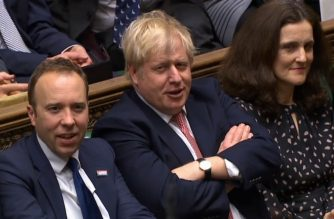 """A video grab from footage broadcast by the UK Parliament's Parliamentary Recording Unit (PRU) shows Britain's Prime Minister Boris Johnson (C) reacting after his Government won the vote on the third reading of the European Union (Withdrawal Agreement) Bill, in the House of Commons in London on January 9, 2020. - The European Union (Withdrawal Agreement) Bill has cleared the House of Commons after getting its third reading by 330 votes to 231. (Photo by HO / PRU / AFP) / RESTRICTED TO EDITORIAL USE - NO USE FOR ENTERTAINMENT, SATIRICAL, ADVERTISING PURPOSES - MANDATORY CREDIT """" AFP PHOTO / PRU """""""