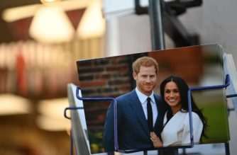 Royal memorabilia featuring Britain's Prince Harry, Duke of Sussex, and Meghan, Duchess of Sussex is displayed for sale in a store near Buckingham Palace in London on January 10, 2020. - Prince Harry's wife Meghan has returned to Canada following the couple's bombshell announcement that they were quitting their frontline royal duties, it emerged Friday, as the monarch held urgent talks with her family to resolve the crisis. (Photo by DANIEL LEAL-OLIVAS / AFP)
