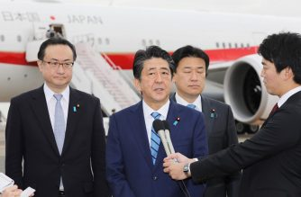 Japanese Prime Minister Shinzo Abe (C) speaks to the media before his departure at Tokyo's Haneda airport on January 11, 2020 for a five-day visit to the Middle East. - Abe will visit the Middle East from January 11, hoping to ease soaring regional tensions after the US killing of a top Iranian general. (Photo by STR / JIJI PRESS / AFP) / Japan OUT
