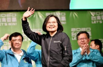 Taiwan's President Tsai Ing-wen (C) waves to supporters outside her campaign headquarters in Taipei on January 11, 2020. - President Tsai Ing-wen declared victory in Taiwan's election on January 11 as votes were being counted after an election battle dominated by the democratic island's fraught relationship with China. (Photo by Sam Yeh / AFP)