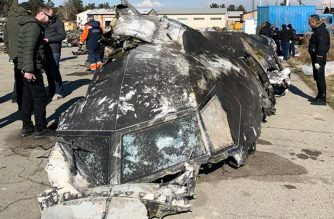"This handout photograph taken and released on January 11, 2020, by The National Security and Defense Council of Ukraine, shows people standing and analysing the fragments and remains of the Ukraine International Airlines plane Boeing 737-800 that crashed outside the Iranian capital Tehran on January 8, 2020. - Iran said on January 11, 2020 it ""unintentionally"" shot down a Ukrainian passenger jet, killing all 176 people aboard, in an abrupt about-turn after initially denying Western claims it was struck by a missile. Iranian president said a military probe into the tragedy had found ""missiles fired due to human error"" brought down the Boeing 737, calling it an ""unforgivable mistake"". (Photo by STR / National Security and Defense Council of Ukraine / AFP) / RESTRICTED TO EDITORIAL USE - MANDATORY CREDIT ""AFP PHOTO /  National Security and Defense Council of Ukraine"" - NO MARKETING NO ADVERTISING CAMPAIGNS - DISTRIBUTED AS A SERVICE TO CLIENTS"
