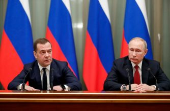 "Russian President Vladimir Putin and Prime Minister Dmitry Medvedev meet with members of the government in Moscow on January 15, 2020. - The Russian government resigned on Wednesday after President Vladimir Putin proposed a series of constitutional reforms, Russian news agencies reported. Prime Minister Dmitry Medvedev said the proposals would make significant changes to the country's balance of power and so ""the government in its current form has resigned."" (Photo by Dmitry ASTAKHOV / SPUTNIK / AFP)"