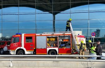 Firefighters work at Alicante-Elche airport on January 15, 2020 in Alicante after a fire erupted in the terminal. (Photo by Daniel LEAL-OLIVAS / AFP)