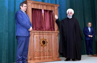"A handout picture provided by the Iranian presidency shows Iranian President Hassan Rouhani (R) and the head of Iran's Central Bank  Naser Hemati, during a ceremony in the capital Tehran on January 16, 2020. - Rouhani said today dialogue with the world was ""possible"" despite high tensions with the United States, and stressed that Tehran was working daily ""to prevent military confrontation or war"". (Photo by - / Iranian Presidency / AFP) / === RESTRICTED TO EDITORIAL USE - MANDATORY CREDIT ""AFP PHOTO / HO / IRANIAN PRESIDENCY"" - NO MARKETING NO ADVERTISING CAMPAIGNS - DISTRIBUTED AS A SERVICE TO CLIENTS ==="