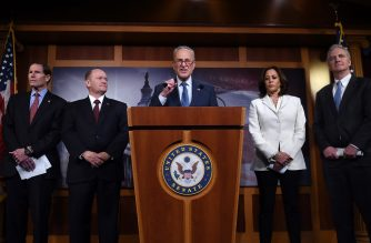 Senate Minority Leader Chuck Schumer (D-NY) (C), flanked by (from L) Senators Richard Blumenthal (D-Conn), Chris Coons (D- DE), Kamala Harris (D-CA) and Chris Van Hollen (D-MD), speaks about the the Senate Impeachment trial at the US Capitol, January 16, 2020, in Washington, DC. - Members of the US Senate were sworn in on January 16 to serve as jurors at the historic impeachment trial of President Donald Trump. (Photo by OLIVIER DOULIERY / AFP)