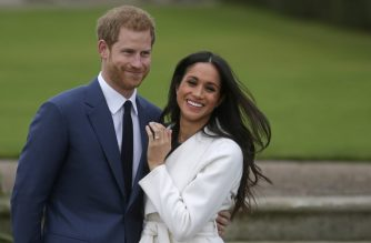 """(FILES) In this file photo taken on on November 27, 2017, Britain's Prince Harry stands with his fiancee US actress Meghan Markle as she shows off her engagement ring whilst they pose for a photograph in the Sunken Garden at Kensington Palace in west London, following the announcement of their engagement. - Britain's Prince Harry and his wife Meghan will give up their titles and stop receiving public funds following their decision to give up front-line royal duties, Buckingham Palace said on January 18, 2020. """"The Sussexes will not use their HRH titles as they are no longer working members of the Royal Family,"""" the Palace said, adding that the couple have agreed to repay some past expenses. (Photo by Daniel LEAL-OLIVAS / AFP)"""