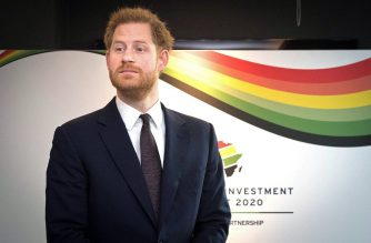 Britain's Prince Harry, Duke of Sussex, reacts as he waits to greet a guest during the UK-Africa Investment Summit in London on January 20, 2020. (Photo by Stefan Rousseau / POOL / AFP)