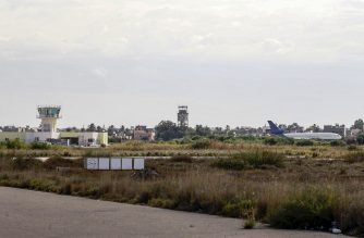 (FILES) A file photo taken on October 29, 2019 shows a view of the Libyan capital Tripoli's Mitiga International Airport. - Rocket fire forced the suspension of all flights into and out of Tripoli's sole functioning airport on January 22, 2020, Libya's embattled UN-recognised government said. (Photo by Mahmud TURKIA / AFP)