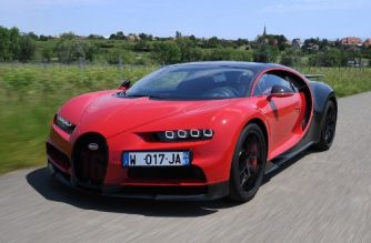 (FILES) In this file photo taken on June 5, 2019 A driver steers a Bugatti Chiron near the luxury automobiles manufacturer Bugatti's headquarters in Molsheim, eastern France. - Every car manufacturers are moving towards hybrid or electric cars, but Bugatti remains a special case, firmly anchored in the niche of the petrol-powered super sports cars. However, the company is trying to regain its ecological virginity by offsetting its CO2 emissions. (Photo by PATRICK HERTZOG / AFP)