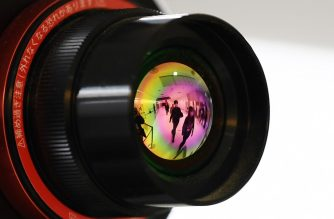 Passengers who arrived on one of the last flights from the Chinese city of Wuhan are reflected in the lens of an advanced thermo camera as they walk through a health screening station at Narita airport in Chiba prefecture, outside Tokyo, on January 23, 2020, as countries screen for anyone showing symptoms of a SARS-like virus which has killed at least 17 people and infected over 500. - China banned trains and planes from leaving Wuhan at the centre of a virus outbreak on January 23, seeking to seal off its 11 million people to contain the contagious disease that has claimed 17 lives, infected hundreds and spread to other countries. (Photo by CHARLY TRIBALLEAU / AFP)