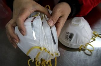 (File photo) This photo taken on January 22, 2020 shows a worker checking facemasks made at a factory in Handan in China's northern Hebei province. - China banned trains and planes from leaving Wuhan at the centre of a virus outbreak on January 23, seeking to seal off its 11 million people to contain the contagious disease that has claimed 17 lives, infected hundreds and spread to other countries. (Photo by STR / AFP)