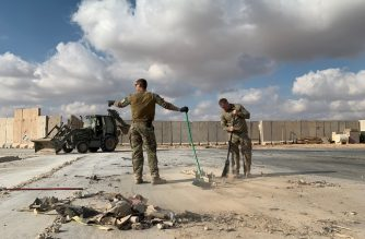 "(FILES) A file picture taken on January 13, 2020 during a press tour organized by the US-led coalition fighting the remnants of the Islamic State group, shows US soldiers clearing rubble at Ain al-Asad military airbase in the western Iraqi province of Anbar. - Nearly three dozen US troops suffered traumatic brain injuries or concussion in the recent Iranian air strike on a military base in Iraq housing American personnel, the Pentagon said on January 24, 2020. ""Thirty-four total members have been diagonosed with concussions and TBI (traumatic brain injury),"" Pentagon spokesman Jonathan Hoffman told reporters. (Photo by Ayman HENNA / AFP)"