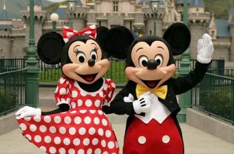 (FILES) This file photo taken on July 20, 2005 shows Walt Disney characters Mickey Mouse and Minnie Mouse posing at the Disneyland theme park in Hong Kong ahead of the park's opening later in the year. - Hong Kong's Disneyland announced it was shutting its doors on January 26, 2020 until further notice over the deadly virus outbreak in central China, a day after city authorities classified the crisis as an emergency. (Photo by Mike CLARKE / AFP)
