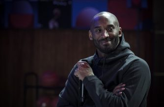 "(FILES) In this file photo taken on October 21, 2017 former NBA basketball player Kobe Bryant attends a promotional event organized by the sports brand Nike, for the inauguration of the infrastructure improvements of a local basketball playground at the Jean-Jaures sports hall ""Le Quartier"", in Paris. - According to multiple US media sources,  Kobe Bryant died in a helicopter crash in Calabasas, California on January 26, 2020. (Photo by PHILIPPE LOPEZ / AFP)"