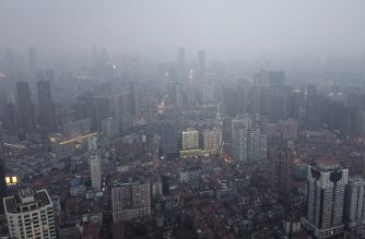An aerial view shows residential and commercial buildings of Wuhan in China's central Hubei province on January 27, 2020, amid a deadly virus outbreak which began in the city. - China on January 27 extended its biggest national holiday to buy time in the fight against a viral epidemic and neighbouring Mongolia closed its border, after the death toll spiked to 81 despite unprecedented quarantine measures. (Photo by Hector RETAMAL / AFP)