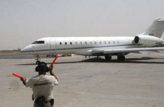 (FILES) US Air Force file photo dated May 25, 2012 obtained January 27, 2020 shows a ground crew member directing the E-11A to the taxiway to prepare for take off at Kandahar Airfield, Afghanistan, May 25, 2012. - The US Defense Department confirmed January 27, 2020 that a military jet crashed in Ghazni province in Afghanistan, but rejected Taliban suggestions that it was shot down. Afghanistan US Forces spokesman Colonel Sonny Leggett confirmed in a statement that the aircraft was a US Bombardier E-11A, a type of jet used as an airborne communications node in the region. He gave no information on casualties in the crash. The primary mission of the E-11A is to provide real-time tactical data links encompassing line-of-sight and beyond line-of-sight situations for airborne and surface operators. (Photo by Sgt. Heather Skinkle / US AIR FORCE / AFP) / RESTRICTED TO EDITORIAL USE