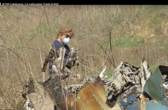 "This still image taken from a January 27, 2020,video released by the National Transportation Safety Board (NTSB), shows a NTSB official inspecting the remains of a helicopter which crashed near Calabasa, California, on January 26, 2020, killing retired NBA star Kobe Bryant, his daughter, Gianna, and seven others. - Investigators have recovered the bodies of all nine people who died in the helicopter crash that killed NBA legend Kobe Bryant, the coroner's office said January 28, 2020. The remains were ""removed from the crash site and transported to the department's forensic science center"" for examination and identification, the Los Angeles County coroner's office said in a statement. (Photo by Jose ROMERO / National Transportation Safety Board / AFP) / RESTRICTED TO EDITORIAL USE - MANDATORY CREDIT ""AFP PHOTO / National Transportation Safety Board"" - NO MARKETING - NO ADVERTISING CAMPAIGNS - DISTRIBUTED AS A SERVICE TO CLIENTS"