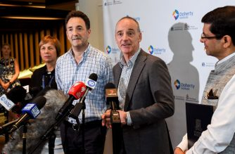 "Dr Mike Catton (centre R) and Dr Julian Druce (centre L) speak during a press conference at the Doherty Institute in Melbourne on January 29, 2020. - Scientists in Australia have successfully replicated the deadly Wuhan coronavirus, in what they said would be a ""game changer"" in the fight against a deadly epidemic which has stricken thousands. (Photo by William WEST / AFP)"
