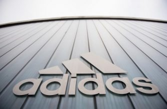 The logo of German sport brand Adidas is pictured on an Outlet Center in Herzogenaurach on January 25, 2016. (Photo by LUKAS BARTH / AFP)
