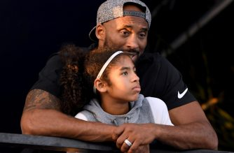 IRVINE, CA - JULY 26: Kobe Bryant and daughter Gianna Bryant watch during day 2 of the Phillips 66 National Swimming Championships at the Woollett Aquatics Center on July 26, 2018 in Irvine, California.   Harry How/Getty Images/AFP