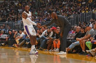 LOS ANGELES, CA - NOVEMBER 17: LeBron James #23 of the Los Angeles Lakers high fives NBA Legend, Kobe Bryant during the game against the Atlanta Hawks on November 17, 2019 at STAPLES Center in Los Angeles, California. NOTE TO USER: User expressly acknowledges and agrees that, by downloading and/or using this Photograph, user is consenting to the terms and conditions of the Getty Images License Agreement. Mandatory Copyright Notice: Copyright 2019 NBAE   Andrew D. Bernstein/NBAE via Getty Images/AFP