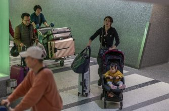LOS ANGELES, CA - JANUARY 18: People arrive to Los Angeles International Airport after touchdown of an Air China flight from Beijing, which serves as a connector from Wuhan, China to Los Angeles, on the first day of health screenings for coronavirus of travelers from Wuhan on January 18, 2020 in Los Angeles, California. Coronavirus is a new type of virus similar in the same classification as SARS and MERS that has health officials concerned. The outbreak that has infected dozens of people in Wuhan and killed at least two.   David McNew/Getty Images/AFP