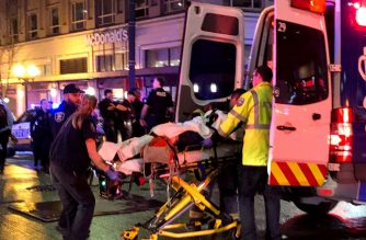 SEATTLE, WA - JANUARY 22: EMT and Police give first aid to a shooting victim in downtown on January 22, 2020 in Seattle, Washington. As many as seven people have been reportedly injured and police are still searching for the suspect.   Chris Porter/Getty Images/AFP