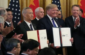 WASHINGTON, DC - JANUARY 15: U.S. President Donald Trump and Chinese Vice Premier Liu He, hold up signed agreements of phase 1 of a trade deal between the U.S. and China, in the East Room at the White House, on January 15, 2020 in Washington, DC. Phase 1 is expected to cut tariffs and promote Chinese purchases of U.S. farm, and manufactured goods while addressing disputes over intellectual property.   Mark Wilson/Getty Images/AFP