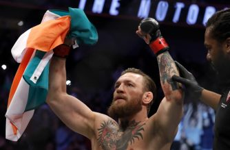 LAS VEGAS, NEVADA - JANUARY 18: Conor McGregor celebrates after defeating Donald Cerrone in a welterweight bout during UFC246 at T-Mobile Arena on January 18, 2020 in Las Vegas, Nevada. McGregor won by a TKO in the first round.   Steve Marcus/Getty Images/AFP